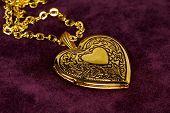 stock photo of heart shape  - gold heart shape locket - JPG
