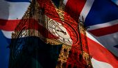 union jack flag and iconic Big Ben at the palace of Westminster, London - the UK prepares for new el poster