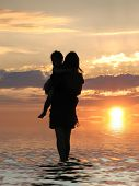 stock photo of mother child  - Mother with child on a sunset background - JPG
