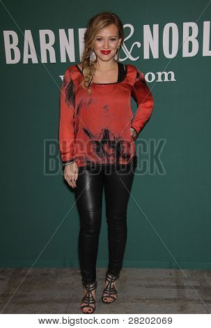 LOS ANGELES - OCT 14:  Hilary Duff signs 'Devoted'  on October 14, 2011 in Los Angeles, CA