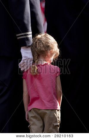 NEW YORK - SEPT 11: An unknown child stands next to a Firefighter during a ceremony at the Firefighters Memorial on September 11, 2011 in New York. Today is the 10TH anniversary of the WTC attacks.