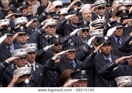 NEW YORK - SEPT 11: Firefighters salute during a ceremony at the Firefighters Memorial on September 11, 2011 in New York. Firefighters from around the world attended the ceremony.