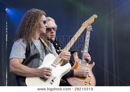 CLARK, NJ - SEPT 17: Guitar players Markus Wolfe and Howard Leese perform with The Paul Rodgers Band at the Union County Music Fest on September 17, 2011 in Clark, NJ.