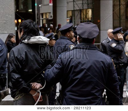 NEW YORK - NOV 17:  An unidentified man being arrested at Broad & Beaver Streets on November 17, 2011 in New York City, NY. Dubbed 'Day of Disruption', it is the 2 month mark since the movement began.