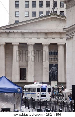 NEW YORK - NOV 17: A police vehicle parked outside Federal Hall and the NY Stock Exchange on the 'Day of Disruption' on November 17, 2011 in New York City, NY. The area was temporarily cleared by police.