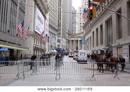 NEW YORK - NOV 17: Police officers temporarily clear the area at Broad Street and Exchange Place near the entrance to the NY Stock Exchange on the 'Day of Disruption' on November 17, 2011 in New York City, NY.