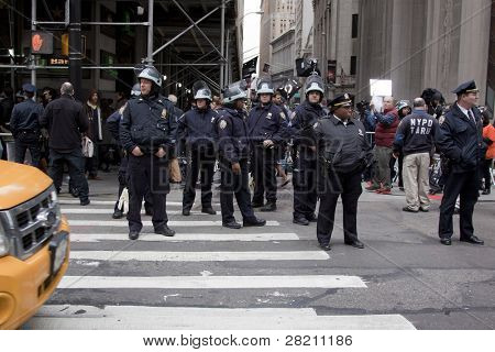 NEW YORK - NOV 17:  A police officer directs traffic on Broadway at Wall St near the entrance to the New York Stock Exchange on the 'Day of Disruption' on November 17, 2011 in New York City, NY.