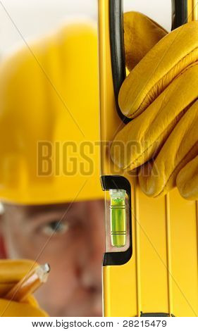 construction concept, selective focus on foreground (nearest part of tool), shallow depth of field