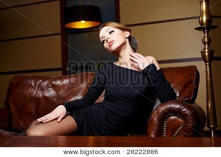 Beautiful elegant woman in a luxury hotel