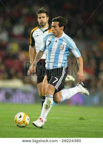 BARCELONA, SPAIN - DEC. 22: Argentinian player Ezequiel Lavezzi in action during the friendly match between Catalonia vs Argentina at Camp Nou Stadium Dec. 22, 2009 in Barcelona.