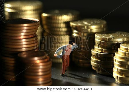 Business figure leaving coins environment