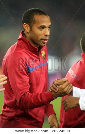 BARCELONA - JAN 16: FC Barcelona  player Henry before Spanish soccer league match between FC Barcelona and Sevilla at the Nou Camp Stadium on January 16, 2010 in Barcelona, Spain.