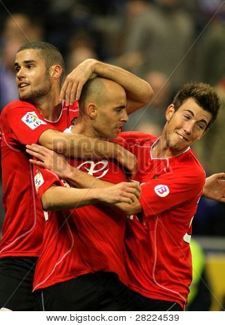 BARCELONA - JAN 24: Mario, Borja and Enrich of Mallorca celebrate goal during a Spanish League match against RCD Espanyol de Barcelona at the Estadi Cornella on January 24, 2010 in Barcelona, Spain
