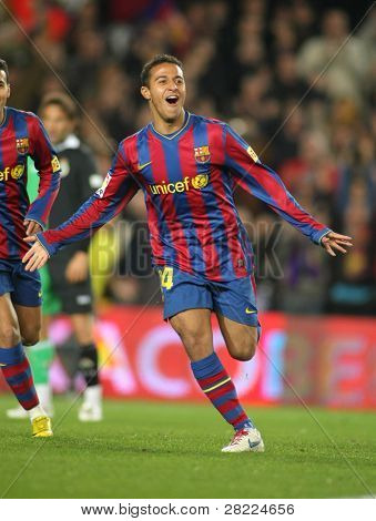 BARCELONA - FEB 20: Thiago Alcantara of Barcelona celebrates a goal during Spanish league match between Barcelona and Santander at the Nou Camp Stadium on February 20, 2010 in Barcelona, Spain.