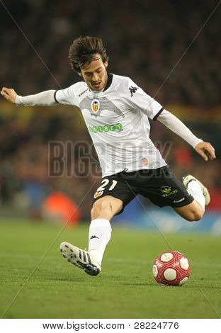 BARCELONA - MARCH 14: David Silva of Valencia CF in action during a Spanish League match between FC Barcelona and Valencia at the Nou Camp Stadium on March 14, 2010 in Barcelona, Spain