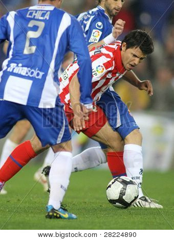 BARCELONA-APRIL 11: Kun Aguero of Atletico Madrid in action during a Spanish League match between Espanyol and Atletico Madrid at the Estadi Cornella on April 11, 2010 in Barcelona, Spain