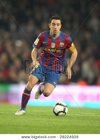 BARCELONA-APRIL 14: Xavi Hernandez of Barcelona in action during a Spanish League match between FC Barcelona and RC Deportivo at the Nou Camp Stadium on April 14, 2010 in Barcelona, Spain