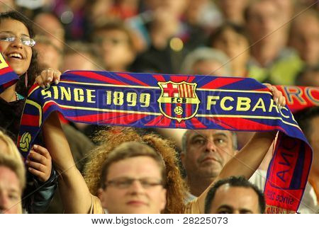 BARCELONA, SPAIN - MAY 16: FC Barcelona supporters enjoying during a Spanish League match between FC Barcelona and Valladolid at the Nou Camp Stadium on May 16, 2010 in Barcelona, Spain