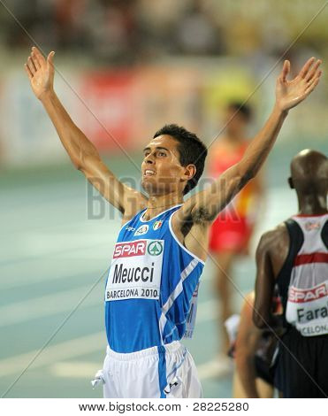 BARCELONA, SPAIN - JULY 27: Daniele Meucci of Italy celebrates bronze on Men 10000m final during the 20th European Athletics Championships at the Olympic Stadium on July 27, 2010 in Barcelona, Spain