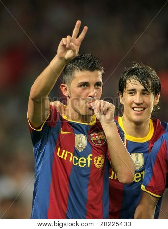 BARCELONA - AUGUST 25: David Villa of Barcelona celebrates goal Trophy Joan Gamper match between FC Barcelona and AC Milan at Nou Camp Stadium on August 25, 2010 in Barcelona, Spain.
