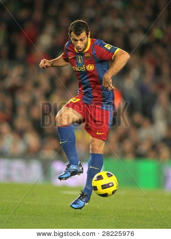 BARCELONA - OCT 30: Javier Mascherano of FC Barcelona in action during spanish league match between FC Barcelona and Sevilla FC at Nou Camp Stadium on October 30, 2010 in Barcelona, Spain
