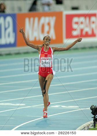 BARCELONA - AUG 1: Alemitu Bekele of Turkey celebrates victory on 5000m women of the 20th European Athletics Championships at the Olympic Stadium on August 1, 2010 in Barcelona, Spain