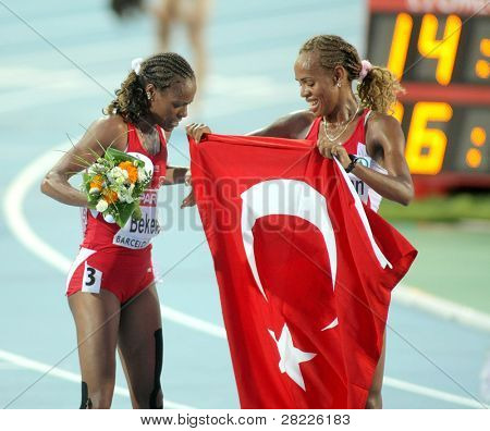 BARCELONA - AUG 1: Erdogan and Bekele of Turkey celebrate victory on 5000m women final of the 20th European Athletics Championships at the Olympic Stadium on August 1, 2010 in Barcelona, Spain