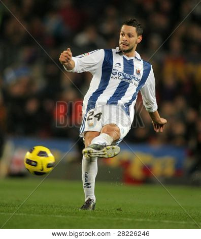 BARCELONA - DEC 12: Alberto de la Bella of Real Sociedad in action during a Spanish League match between FC Barcelona and Real Sociedad at the Nou Camp Stadium on December 12, 2010 in Barcelona, Spain