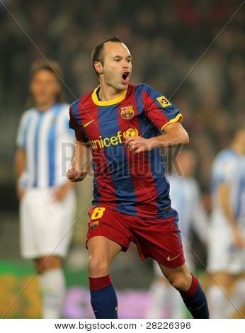 BARCELONA - JAN 16: Andres Iniesta of Barcelona celebrates goal  during the match between FC Barcelona and Malaga CF at the Nou Camp Stadium on January 16, 2011 in Barcelona, Spain