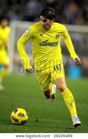 BARCELONA - JAN 30: Cani of Villareal goes after the ball during a Spanish League match between Espanyol and Villareal at the Estadi Cornella on January 30, 2011 in Barcelona, Spain