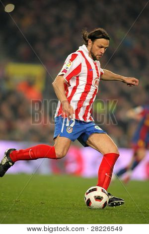 BARCELONA - FEB 5: Tomas Ujfalusi of Atletico Madrid during the match between FC Barcelona and Atletico Madrid at the Nou Camp Stadium on February 5, 2011 in Barcelona, Spain