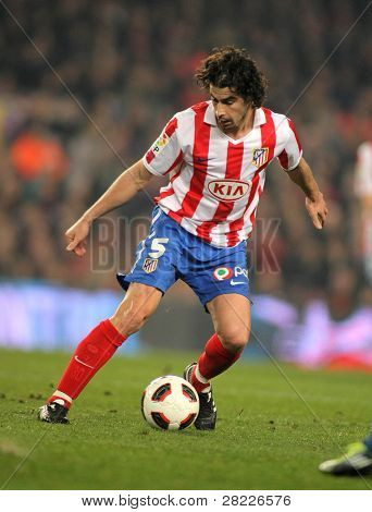 BARCELONA - FEB 5: Tiago Mendes of Atletico de Madrid during the match between FC Barcelona and Atletico Madrid at the Nou Camp Stadium on February 5, 2011 in Barcelona, Spain
