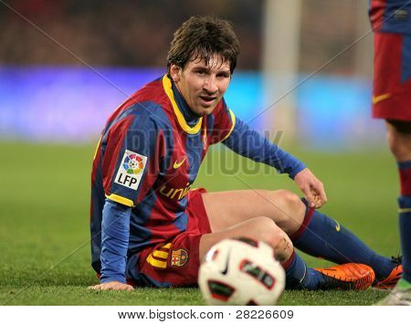 BARCELONA - FEB 20: Messi of Barcelona fallen to the ground during the match between FC Barcelona and Athletic de Bilbao at the Nou Camp Stadium on February 20, 2011 in Barcelona, Spain