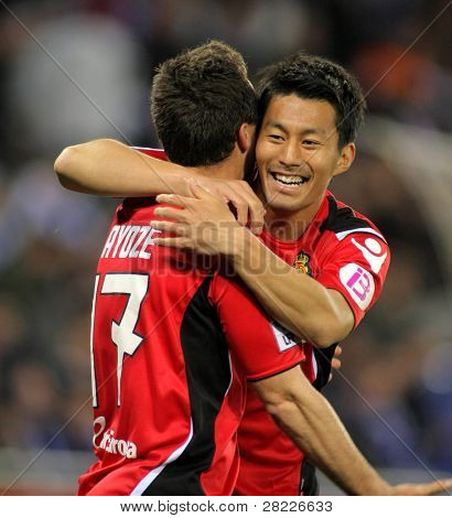 BARCELONA - MAR 1: Akihiro Ienaga (R) of Mallorca celebrates goal during the match between Espanyol and Real Mallorca at the Estadi Cornella on March 1, 2010 in Barcelona, Spain