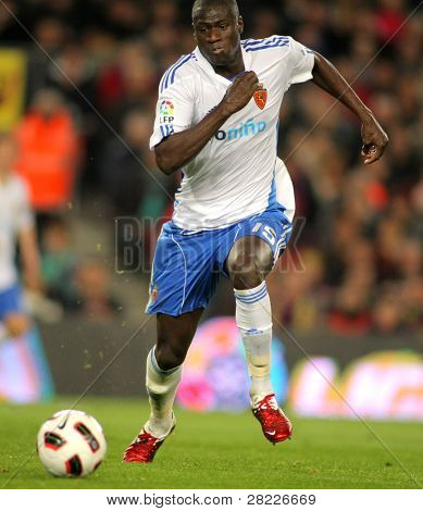 BARCELONA - MARCH 5: Guirane N'Daw of Zaragoza during the match between FC Barcelona and Real Zaragoza at the Nou Camp Stadium on March 5, 2011 in Barcelona, Spain
