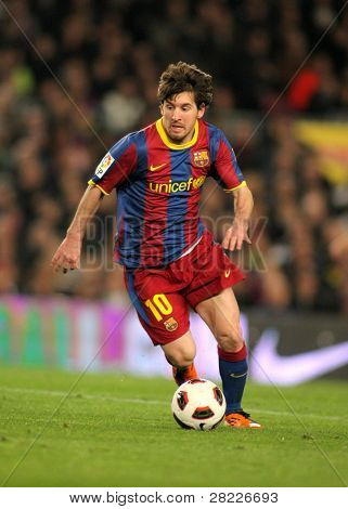 BARCELONA - MARCH 5: Leo Messi of Barcelona during the match between FC Barcelona and Real Zaragoza at the Nou Camp Stadium on March 5, 2011 in Barcelona, Spain