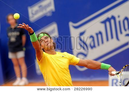 BARCELONA - APRIL 20: Spanish tennis player Rafael Nadal in action during his match against Gimeno-Traver of   Barcelona tennis tournament Conde de Godo on April 20, 2011 in Barcelona, Spain