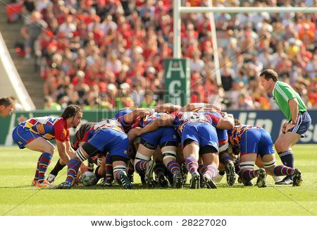 BARCELONA - APRIL 9: USAP Perpignan players scrumming during the Heineken European Cup quarter-final match USAP Perpignan against RC Toulon on April 9, 2011 at the Olympic Stadium in Barcelona, Spain.
