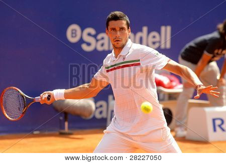 BARCELONA - APRIL 21: Romanian tennis player Victor Hanescu in action during his match against David Ferrer  of Barcelona tennis tournament Conde de Godo on April 21, 2011 in Barcelona, Spain