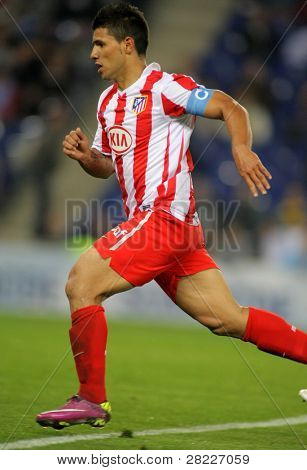 BARCELONA - APRIL 17: Kun Aguero of Atletico Madrid in action during a Spanish League match between Espanyol and Atletico Madrid at the Estadi Cornella on April 17, 2011 in Barcelona, Spain