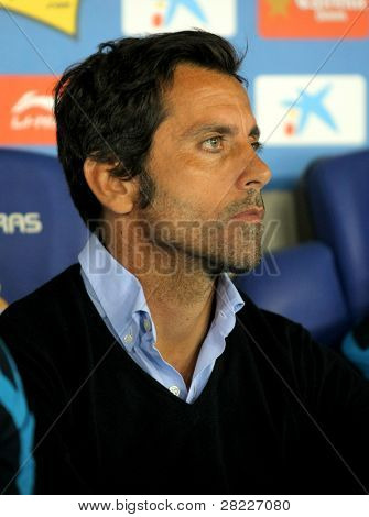 BARCELONA - APRIL 17: Atletico Madrid coach Quique Sanchez Flores  during  the match between Espanyol and Atletico Madrid at the Estadi Cornella on April 17, 2011 in Barcelona, Spain