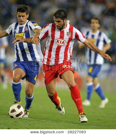 BARCELONA -APRIL 17: Raul Garcia(R) of Atletico Madrid fight with Javi Marquez(L) of Espanyol in match between Espanyol and Atletico at the Estadi Cornella on April 17, 2011 in Barcelona, Spain