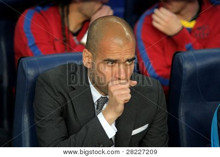 BARCELONA - MAY 15: Josep Guardiola manager of Barcelona during spanish league match between FC Barcelona and Deportivo La Coruna at Nou Camp Stadium May 15, 2011 in Barcelona, Spain