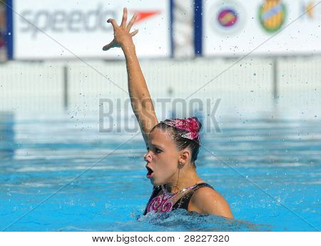 BARCELONA - JUNE 19: Hungarian synchro swimmer Eszter Czekus in a Solo Free Rutine during the Espana Sincro meeting in Barcelona Picornell Swimpool, June 19, 2011 in Barcelona, Spain