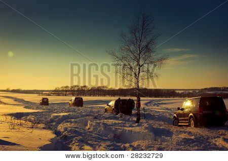 Four SUV on a winter sunset