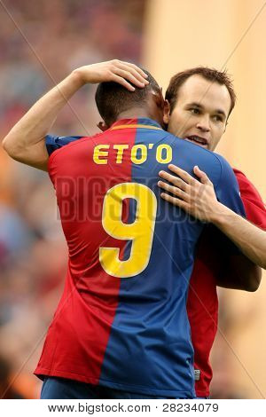 BARCELONA, SPAIN : Iniesta Futbol Club Barcelona player and Cameroonian Eto'o celebrate a goal during the match between FC Barcelona and Villarreal FC in Nou Camp in Barcelona, Spain. May 10, 2009.