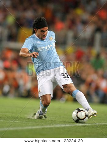 BARCELONA, SPAIN - AUG. 19: Manchester City international Argentinian striker Carlos Tevez during the match Trophy Joan Gamper between FC Barcelona and Manchester City at Nou Camp Stadium in Barcelona, Spain. August 19, 2009.