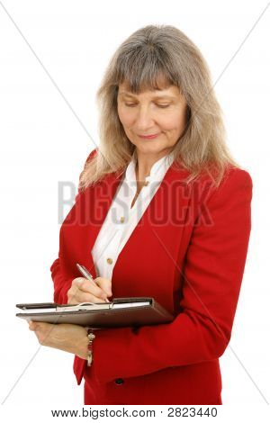 Mature Businesswoman Taking Notes