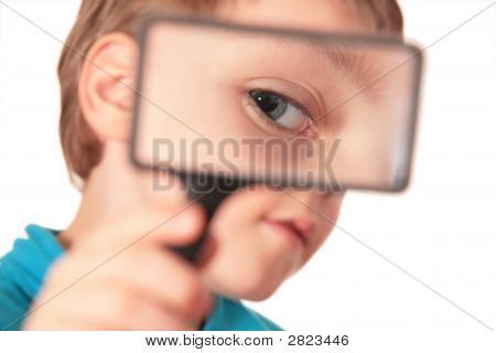 Child Looks Through Magnifier