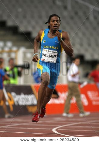 BARCELONA JULY 25: Bahamian athlete Andrae Williams runs to win his men's 400 meters hurdles at the Meeting Ciutat de Barcelona athletics event on July 25, 2009 in Barcelona, Spain.
